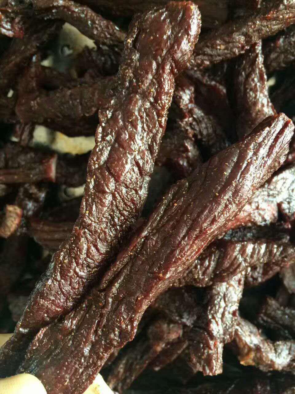 这是第3张纯正风干牛肉干纯手工古法制作真正的老味道的货源图片